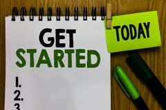 Text sign showing Get Started. Conceptual photo asking someone to begin task endeavour or process right now Notebook clothespin ho. Lding reminder markers stock photography