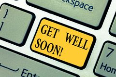 Text sign showing Get Well Soon. Conceptual photo Wishing you have better health than now Greetings good wishes Keyboard stock photography