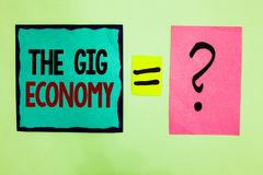 Text sign showing The Gig Economy. Conceptual photo Market of Short-term contracts freelance work temporary Black lined written no. Te middle queal pink page royalty free stock images