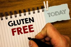 Text sign showing Gluten Free. Conceptual photos Diet with products not containing ingredients like wheatMan creating for today on. Text sign showing Gluten Free stock photography