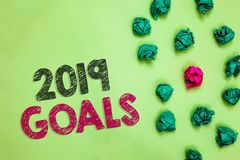 Text sign showing 2019 Goals. Conceptual photo A plan to do for something new and better for the coming year Crumpled wrinkled pap. Ers one different pink unique royalty free stock photo