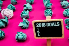 Text sign showing 2018 Goals 1. 2. 3.. Conceptual photo Resolution Organize Beginnings Future Plans Blackboard with white letter p. Ink base much green paper stock photos