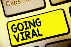 Text sign showing Going Viral. Conceptual photo image video or link that spreads rapidly through population Keyboard yellow key In stock illustration