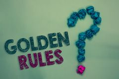 Text sign showing Golden Rules. Conceptual photo Basic principle that should be followed Important Principle Crumpled papers formi. Ng question mark several stock photos