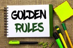 Text sign showing Golden Rules. Conceptual photo Regulation Principles Core Purpose Plan Norm Policy Statement written on Notebook. Text sign showing Golden Stock Photography