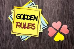 Text sign showing Golden Rules. Conceptual photo Regulation Principles Core Purpose Plan Norm Policy Statement written on Stacked stock image