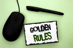 Text sign showing Golden Rules. Conceptual photo Regulation Principles Core Purpose Plan Norm Policy Statement written on Sticky N. Text sign showing Golden Stock Images