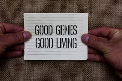 Text sign showing Good Genes Good Living. Conceptual photo Inherited Genetic results in Longevity Healthy Life Man holding piece n. Otebook paper jute background stock photo