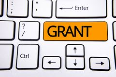 Text sign showing Grant. Conceptual photo Money given by an organization or government for a purpose Scholarship written on Orange. Text sign showing Grant stock photos