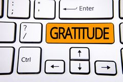Text sign showing Gratitude. Conceptual photo Quality of being thankful Appreciation Thankfulness Acknowledge written on Orange Ke. Text sign showing Gratitude Royalty Free Stock Photos