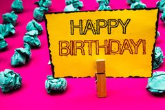 Text sign showing Happy Birthday Motivational Call. Conceptual photo Congratulations Celebrating Anniversary Clothespin hold holdi. Ng yellow paper black red royalty free stock photos