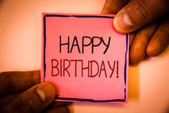 Text sign showing Happy Birthday Motivational Call. Conceptual photo Congratulations Celebrating Anniversary Man hold holding pink. Paper ideas black red stock photos