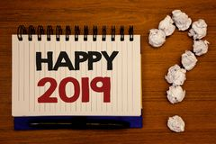 Text sign showing Happy 2019. Conceptual photos New Year Celebration Cheers Congrats Motivational MessageIdeas on notebook wooden. Text sign showing Happy 2019 Stock Images