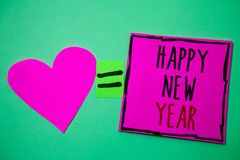 Text sign showing Happy New Year. Conceptual photo congratulations Merry Xmas everyone beginning of January Hart memories love pin. K green background love royalty free stock photo