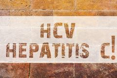 Text sign showing Hcv Hepatitis C. Conceptual photo Liver disease caused by a virus severe chronic illness Brick Wall. Art like Graffiti motivational call royalty free stock images