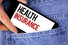 Text sign showing Health Insurance. Conceptual photo Health insurance information coverage healthcare provider written on Mobile p. Text sign showing Health royalty free stock photos