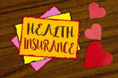 Text sign showing Health Insurance. Conceptual photo Health insurance information coverage healthcare provider written on Sticky n. Text sign showing Health stock photo