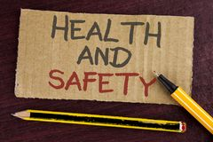 Text sign showing Health And Safety. Conceptual photo being in good condition harmless Workouts Healthy food written on Cardboard. Text sign showing Health And Royalty Free Stock Photos