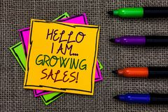 Text sign showing Hello I Am... Growing Sales. Conceptual photo Making more money Selling larger quantities Written on some colorf. Ul sticky note 4 pens laid in stock images
