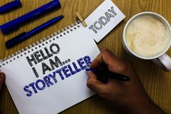 Text sign showing Hello I Am... Storyteller. Conceptual photo introducing yourself as novels article writer Man holding marker not. Ebook clothespin reminder Royalty Free Stock Photography