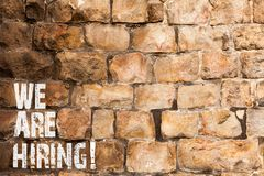 Text sign showing We Are Hiring. Conceptual photo recently employ someone or pay him to do particular job Brick Wall art. Text sign showing We Are Hiring stock images