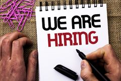 Text sign showing We Are Hiring. Conceptual photo Talent Hunting Job Position Wanted Workforce HR Recruitment written by Man Holdi. Ng Marker Notebook Book the Royalty Free Stock Photos