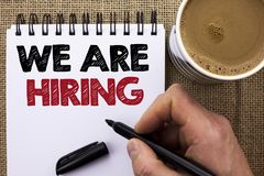 Text sign showing We Are Hiring. Conceptual photo Talent Hunting Job Position Wanted Workforce HR Recruitment written by Man Holdi. Ng Marker Notebook Book the Stock Photography