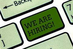 Text sign showing We Are Hiring. Conceptual photo Workforce Wanted HR recruiting new hire employee Vacancy Keyboard key. Intention to create computer message stock image