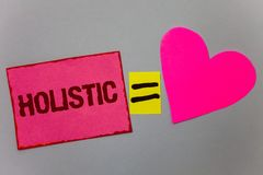 Text sign showing Holistic. Conceptual photo Belief the parts of something are interconnected Related to holism Paper Heart equal