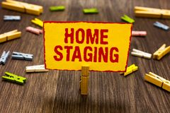 Text sign showing Home Staging. Conceptual photo Act of preparing a private residence for sale in the market Clothespin holding ye. Llow paper note several stock images