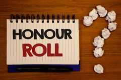 Text sign showing Honour Roll. Conceptual photos List of students who have earned grades above a specific averageIdeas on notebook. Text sign showing Honour Roll Stock Photo