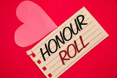 Text sign showing Honour Roll. Conceptual photos List of students who have earned grades above a specific averageNotebook page red. Text sign showing Honour Roll Stock Photo