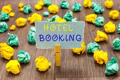 Text sign showing Hotel Booking. Conceptual photo Online Reservations Presidential Suite De Luxe Hospitality Clothespin holding gr. Ay note paper crumpled papers stock photos