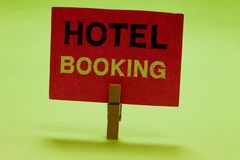Text sign showing Hotel Booking. Conceptual photo Online Reservations Presidential Suite De Luxe Hospitality Clothespin. Holding red paper important royalty free stock image