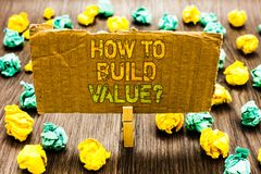 Text sign showing How To Build Value question. Conceptual photo Ways for developing growing building a business Paperclip grip car. Dboard with texts many stock image