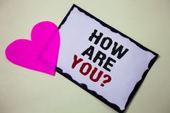 Text sign showing How Are You Question. Conceptual photo Your Health status Asking about your life and health Hart love pink white. Background love lovely royalty free stock image