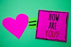 Text sign showing How Are You Question. Conceptual photo Your Health status Asking about your life and health Hart memories love p. Ink green background love royalty free stock photo