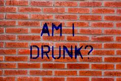 Text sign showing Am I Drunk. Conceptual photo Doubtful if my alcohol levels are high addiction alcoholism Brick Wall. Art like Graffiti motivational call royalty free stock photo