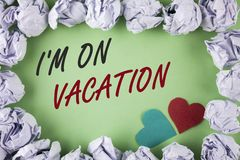 Text sign showing I Am im On Vacation. Conceptual photo Break from stressful work pressure travel worldwide written on plain green. Text sign showing I Am im On Stock Images