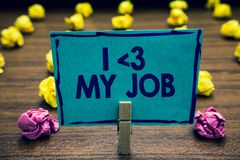 Text sign showing I love My Job. Conceptual photo telling someone that you admire your current profession Clothespin holding blue. Paper note crumpled papers stock photo