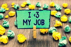 Text sign showing I love My Job. Conceptual photo telling someone that you admire your current profession Clothespin holding green. Note paper crumpled papers royalty free stock image