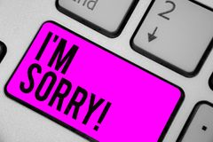 Text sign showing I am Sorry. Conceptual photo To ask for forgiveness to someone you unintensionaly hurt Keyboard purple key Inten. Tion create computer royalty free stock image