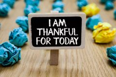 Text sign showing I Am Thankful For Today. Conceptual photo Grateful about living one more day Philosophy Paperclip hold written c. Halkboard behind paper lumps royalty free stock image