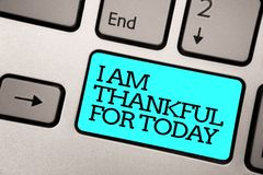 Text sign showing I Am Thankful For Today. Conceptual photo Grateful about living one more day Philosophy Silver grey computer key. Board with blue button black stock photography