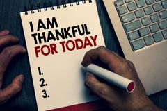 Text sign showing I Am Thankful For Today. Conceptual photo Grateful about living one more day Philosophy Written words. And number on notepad man hold marker royalty free stock images