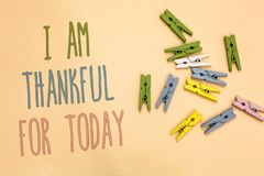 Text sign showing I Am Thankful For Today. Conceptual photo Grateful about living one more day Philosophy Yellow base with painted. Texts colorful paper clips stock images