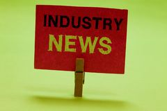 Text sign showing Industry News. Conceptual photo Technical Market Report Manufacturing Trade Builder Clothespin holding. Red paper important communicating stock images