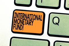 Text sign showing International Monetary Fund. Conceptual photo promotes international financial stability Keyboard key. Intention to create computer message royalty free stock photos