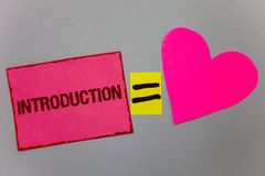 Text sign showing Introduction. Conceptual photo First part of a document Formal presentation to an audience Paper Heart equal sig. N gray background intentions Stock Image