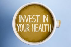 Text sign showing Invest In Your Health. Conceptual photo Spend money in personal healthcare Preventive Tests written on Coffee in. Text sign showing Invest In stock photography